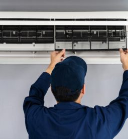 technician-service-removing-air-filter-air-conditioner-cleaning_35076-3618
